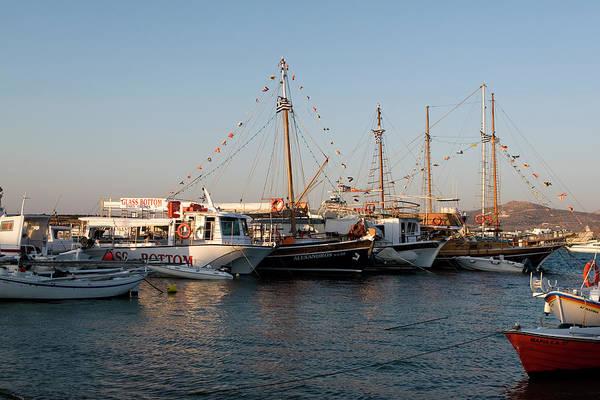 Photograph - Flagged Sail Boats At Naoussa Marina by Lorraine Devon Wilke