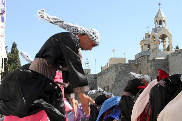 Manger Photograph - Folklore Dance At Olive Festival by Munir Alawi