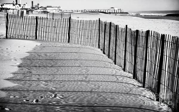 Down The Shore Photograph - Follow The Fence by John Rizzuto