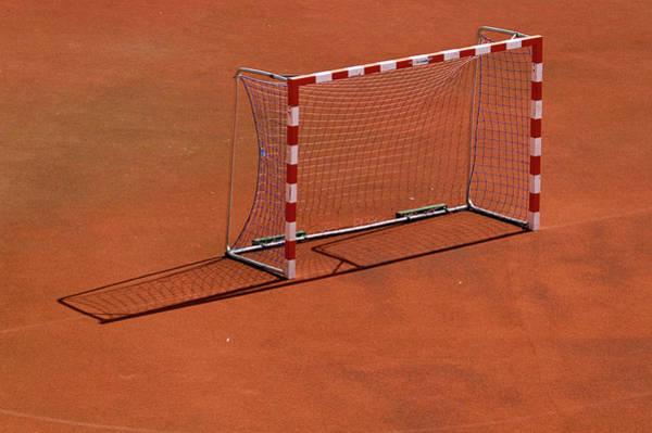 Photograph - Football Net On Red Ground by Daniel Kulinski