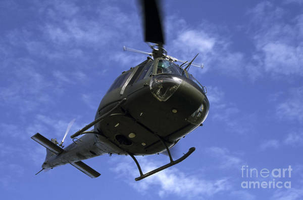 Utility Helicopter Photograph - Former U.s. Air Force Bell Uh-1e Huey by Daniel Karlsson