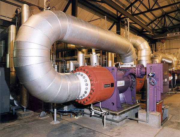 Compressor Photograph - Gas Compressor At An Oil Refinery by Paul Rapson