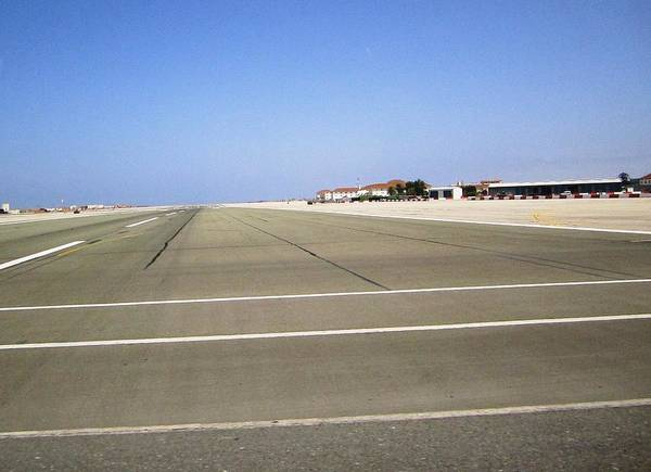 Photograph - Gibraltar Airport Runway Crossing Uk by John Shiron