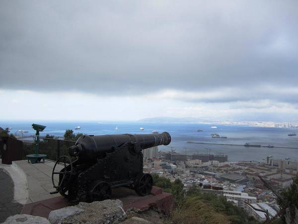 Photograph - Gibraltar Cast Iron Cannon Towards Harbor by John Shiron