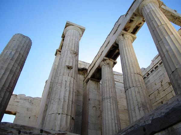 Photograph - Gigantic Acropolis Parthenon Architectural Columns With The Sun Rising And Blue Sky Athens Greece by John Shiron