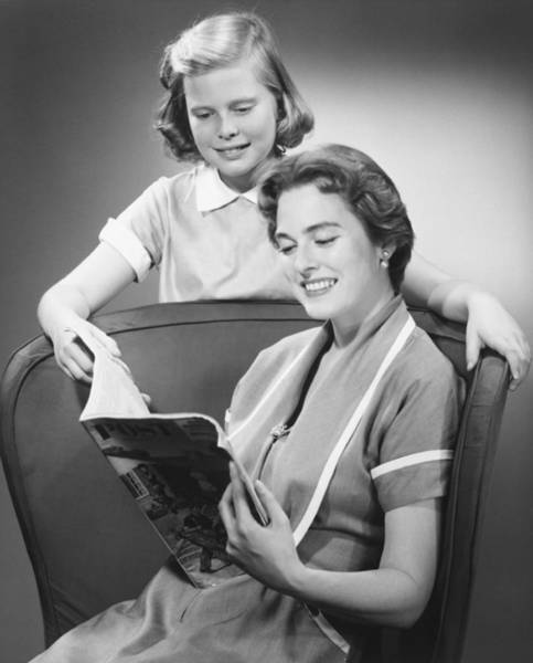 Armchair Photograph - Girl (8-9) Standing At Mother Reading Magazine, (b&w) by George Marks