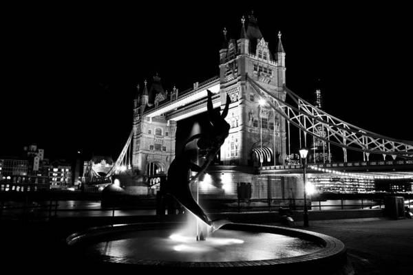 Wall Art - Photograph - Girl And Dolphin Statue And Tower Bridge  by David Pyatt