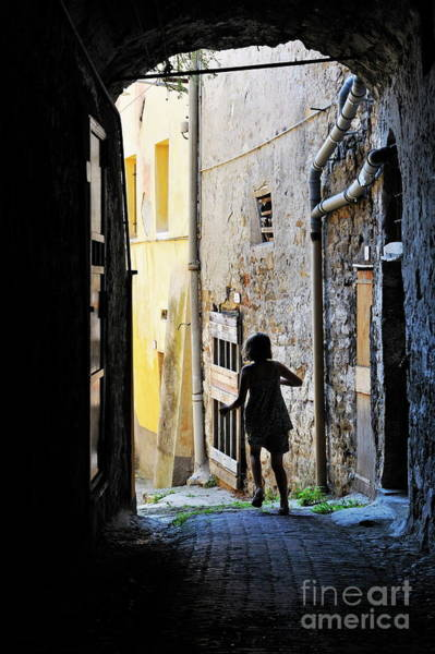 Wall Art - Photograph - Girl Running Through A Cobblestone Street by Sami Sarkis