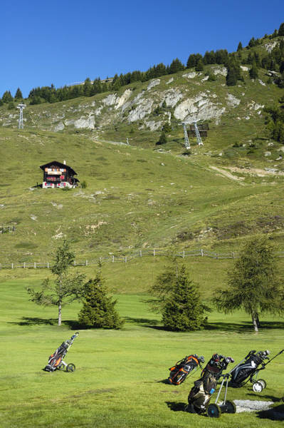 Photograph - Golf Bags On The Green - Gold Course Riederalp Switzerland by Matthias Hauser