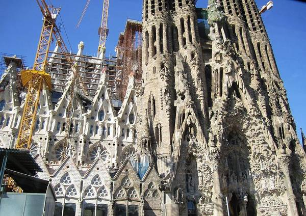 Photograph - Gorgeous Sagrada Familia Cathedral Endures Cranes For Renovation And Upgrading In Barcelona Spain by John Shiron