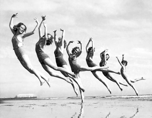 Jumping Photograph - Graceful Line Of Beach Dancers by Underwood Archives