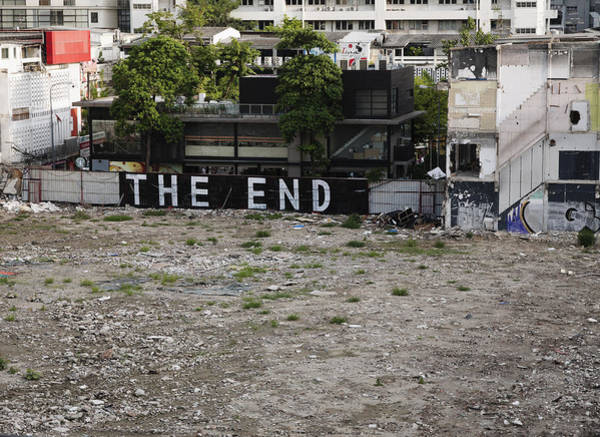 Wall Art - Photograph - Graffiti That Reads The End In An Empty by Roberto Westbrook