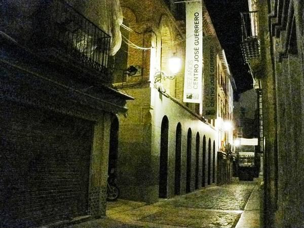 Photograph - Granada Stone Paved Side Street Lamp At Night by John Shiron