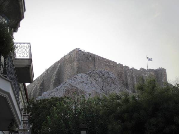 Photograph - Greek Flag Blowing In The Wind Atop Parthenon Acropolis In Athens Greece by John Shiron