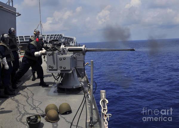 Gunfire Photograph - Gunner Fires A Mark 38 Machine Gun by Stocktrek Images