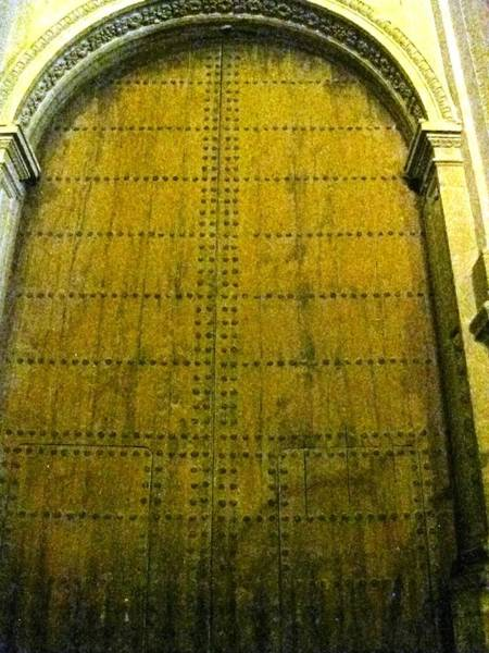 Photograph - Huge Antique Lord's House Doorway At Night Granada Spain by John Shiron