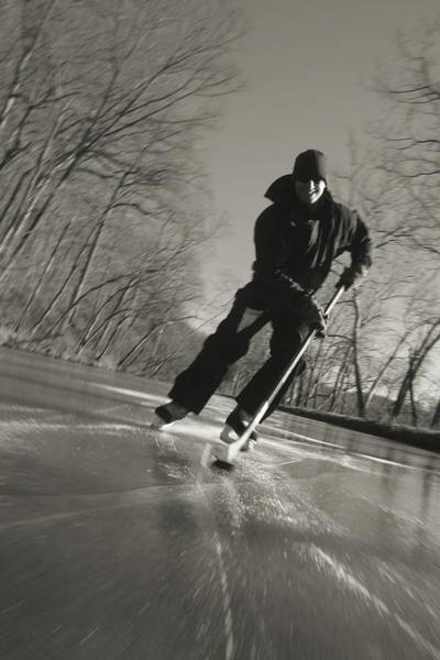 Chesapeake And Ohio Wall Art - Photograph - Ice Skater With A Hockey Stick by Skip Brown