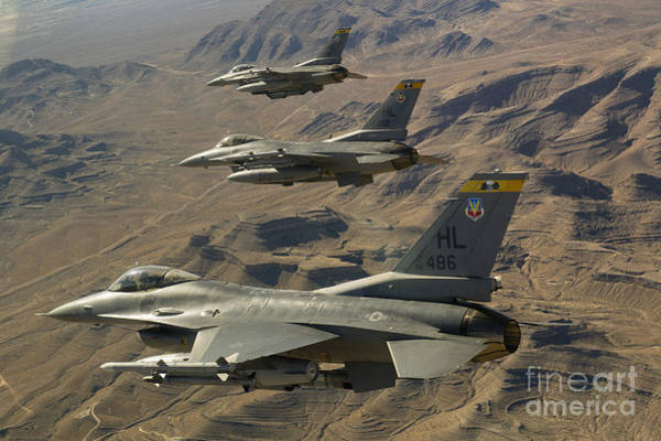 F-16 Photograph - Ighter Jets Return From The Nevada Test by Stocktrek Images