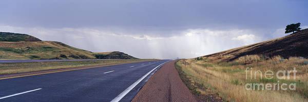 North Dakota Badlands Wall Art - Photograph - Interstate Highway Near Badlands National Park by Jeremy Woodhouse