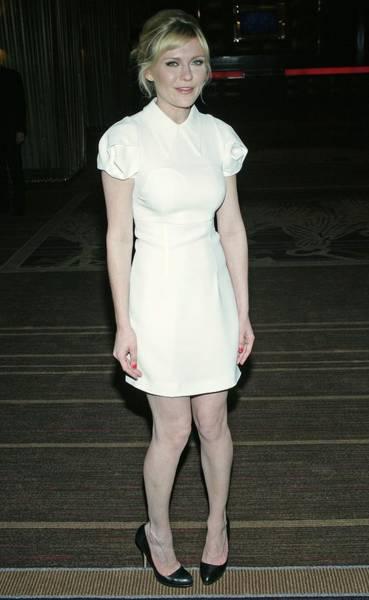 Coldplay Photograph - Kirsten Dunst Wearing A Miu Miu Dress by Everett
