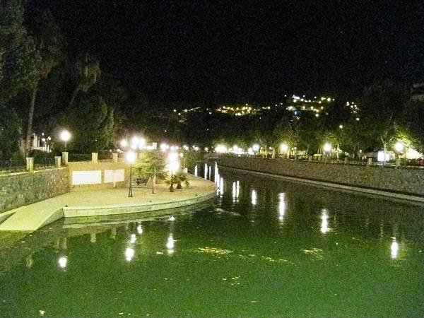 Photograph - Lamp Post Reflection By The River At Night Granada Spain by John Shiron