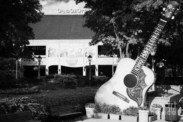Wall Art - Photograph - large guitar outside Grand Ole Opry House building Nashville Tennessee USA by Joe Fox