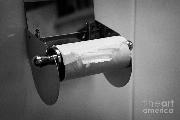 Fairness Wall Art - Photograph - Last Remaining Sheet Of Toilet Paper On A Toilet Roll Holder by Joe Fox