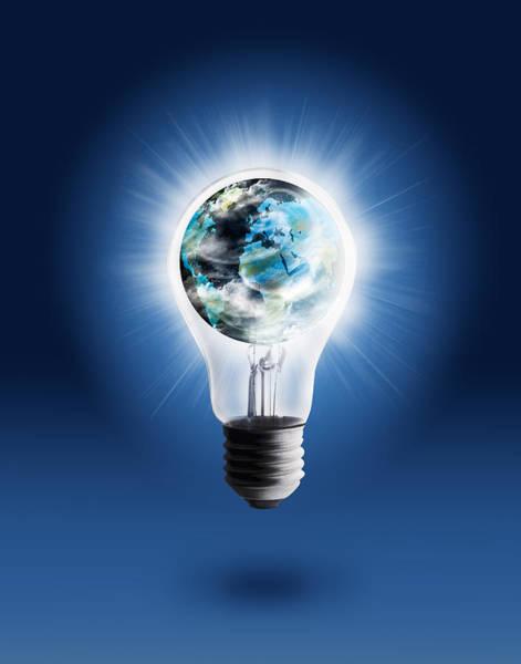 Energy-saving Wall Art - Photograph - Light Bulb With Globe by Setsiri Silapasuwanchai