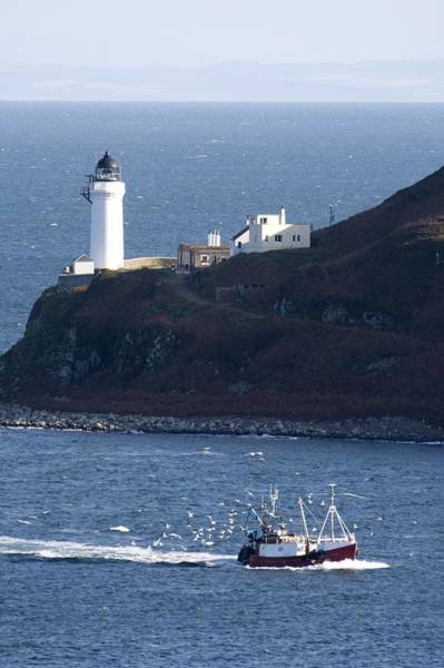 Oceanfront Photograph - Lighthouse On The Coast, Campbeltown by John Short