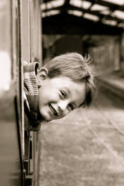 Railway Station Photograph - Little Boy Leaning Out Of A Train Window by Tom Gowanlock