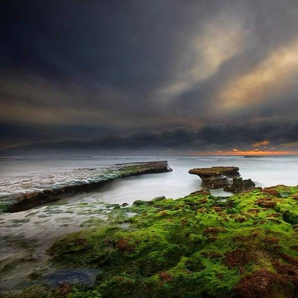 Long Exposure Of A Stormy Sunset At A Art Print by Larry Marshall