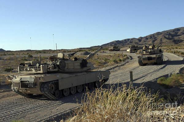 Photograph - M1a1 Abrams Main Battle Tanks by Stocktrek Images