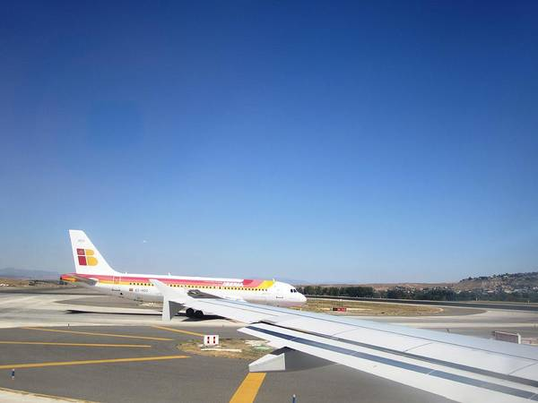 Photograph - Madrid Airport Runway Airplane Waiting In Line To Take Off In Spain by John Shiron
