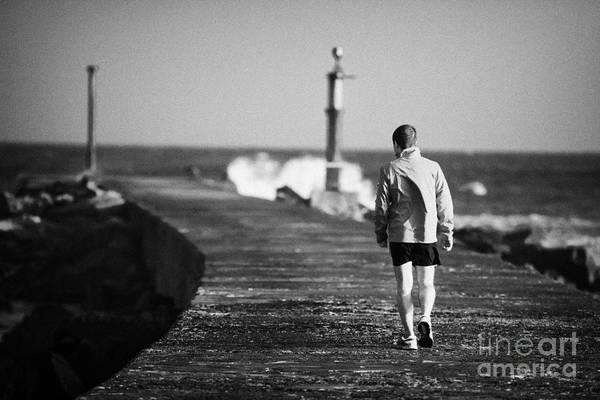 Barmouth Photograph - Man Walking Along Pier Bann Mouth County Derry Londonderry Northern Ireland by Joe Fox