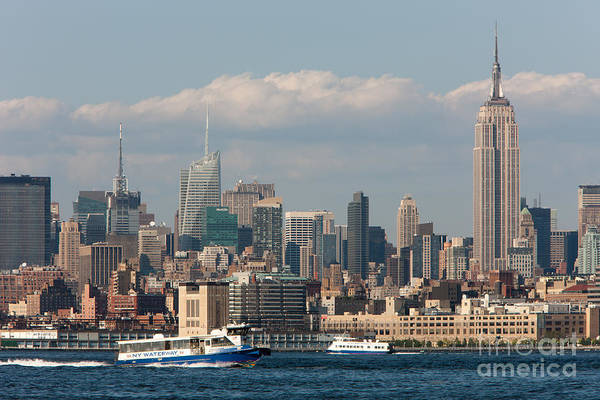 Photograph - Manhattan Skyline And Ferry Traffic by Clarence Holmes