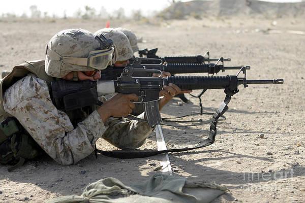 Gunfire Photograph - Marine Fires Their M16a2 Service Rifles by Stocktrek Images