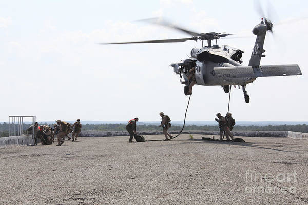 Photograph - Marines Fast-rope Onto Their Objective by Stocktrek Images