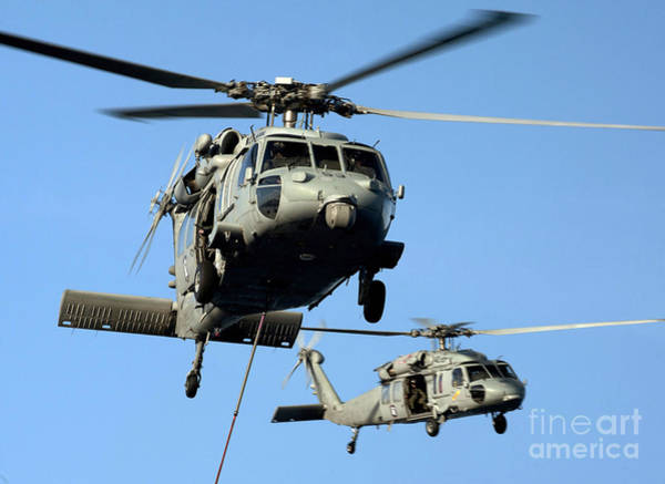 Uss Carl Vinson Photograph - Mh-60s Sea Hawk Helicopters In Flight by Stocktrek Images