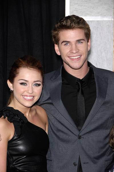 Miley Cyrus Wall Art - Photograph - Miley Cyrus, Liam Hemsworth At Arrivals by Everett