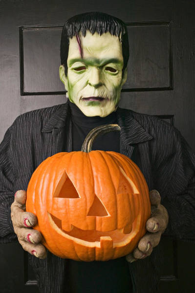 Frankenstein Monster Photograph - Monster Holding Carved Pumpkin by Garry Gay