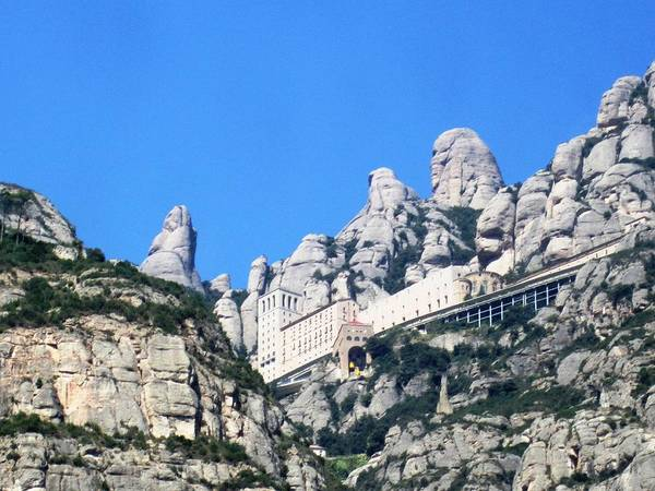 Photograph - Montserrat Monastery Panoramic Mountain View Iv Blue Sky Near Barcelona Spain by John Shiron
