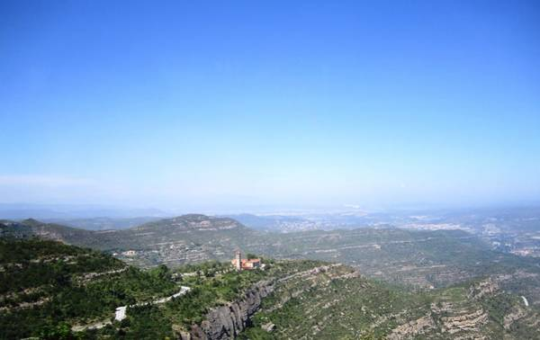 Photograph - Montserrat View IIi As Far As Eye Can See In A Hazy Day At High Altitude In Spain Near Barcelona by John Shiron