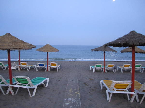 Photograph - Moon Lit Beach Umbrellas And Chairs Costa Del Sol Spain by John Shiron