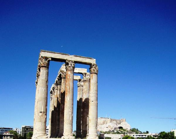 Photograph - Moon Over Corinthian Columns Of The Temple Of Olympian Zeus Acropolis In Background Athens Greece by John Shiron