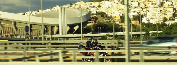 Photograph - Motorcycle Bike Rider Speeding On Athens Highway In Greece by John Shiron