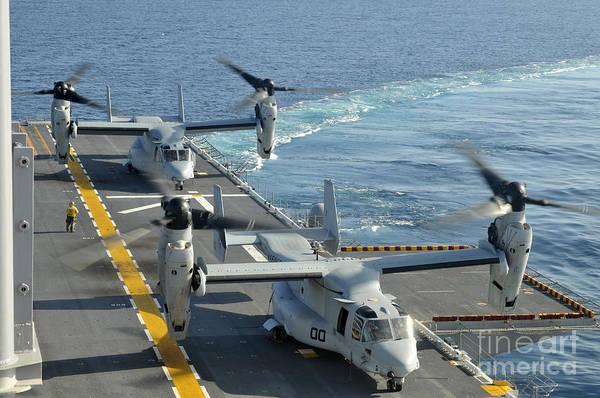 Mv-22 Photograph - Mv-22 Osprey Aircraft Land Aboard Uss by Stocktrek Images