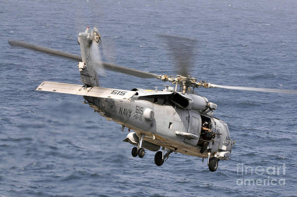 Uss Carl Vinson Photograph - N Hh-60h Sea Hawk Helicopter In Flight by Stocktrek Images