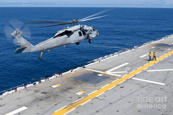 Flight Deck Photograph - N Mh-60s Sea Hawk Helicopter Lifts by Stocktrek Images