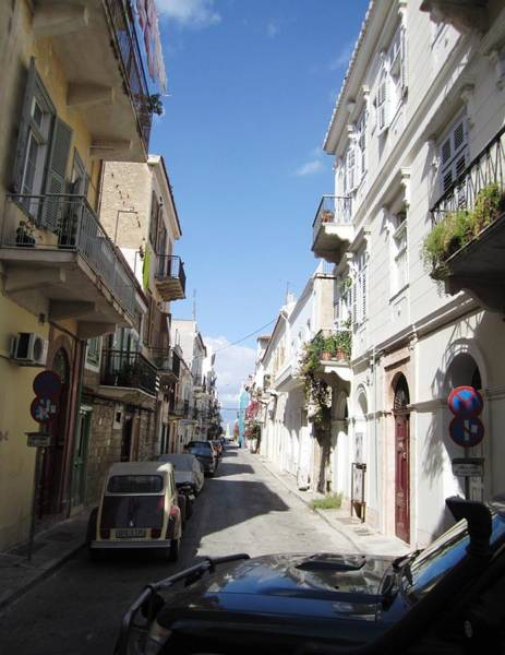 Photograph - Nafplion Bay Narrow Streets With Rows Of Balconies And Old Architecture Buildings In Greece by John Shiron