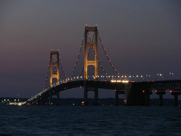 Photograph - Night Approaches The Mackinac Bridge by Keith Stokes